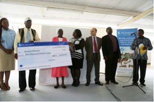 2014 Overall Winners: Mr. and Mrs. Mawara with their award check