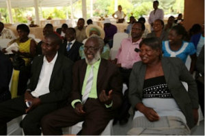 Mr. Phiri (center) and his wife Constance (right) enjoying the proceedings; and Mr. Johnson Madyakuseni (left), long-time colleague now seeking to resuscitate Zvishavane Water Projects, the NGO Mr. Phiri started in 1987