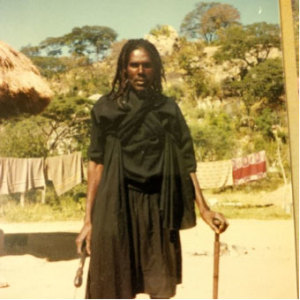 """The late Mr. Spikita Pasira was one of our """"nyusa"""", or spiritual messengers to the rain shrines of in the Matobo Hills.  Moving there in humility with our """"rusengwe"""" offerings, the nyusa return with blessings, seeds and instructions on how we should better harmonize with nature."""