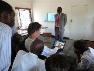 In response to a request from Mr Mudzingwa (standing in center) the headmaster of Gwavachemayi Secondary School the Muonde Trust provided the school's first computers and training to the teachers (through volunteer Robert Hickling) in how to use them.