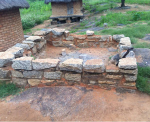 This simple stone structure at Spikita in Madzoke provides much improved seating and food preparation space for cooking in the open air in the evenings without the accumulation of smoke.