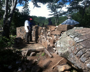Mr. Britain Spikita (second from left) teaching drystone wall building in Madzoke Valley, 2014